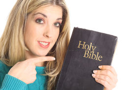 beautiful woman pointing at the bible
