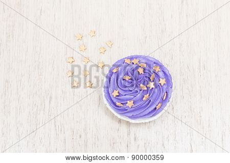 Chocolate cupcakes with purple cream
