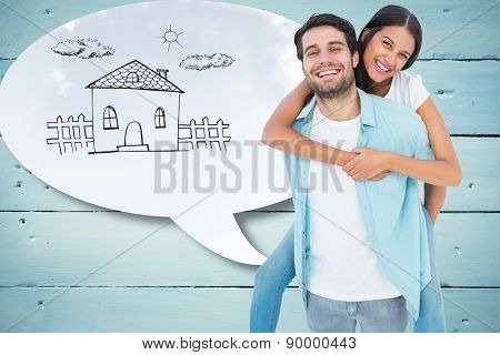 Happy casual man giving pretty girlfriend piggy back against blue sky