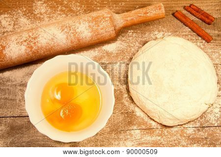 Homemade Baking. Fresh Dough For Pastry, Stick Cinnamon, Spilled Flour, Broken Eggs On A Chopping Bo