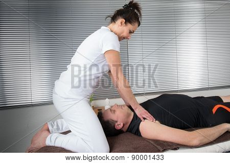 Man Relaxing Getting A Shoulder Massage At Spa Center