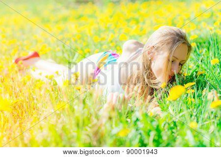 Sensual Woman Lying On Flowery Meadow Sniffs