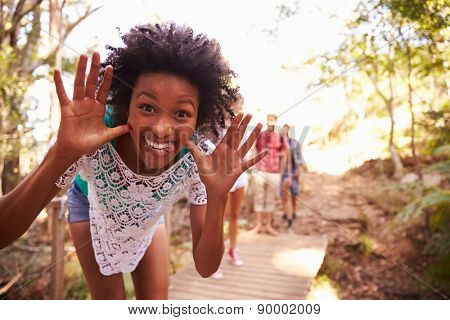 Woman On Walk With Friends Making Pilling Face At Camera