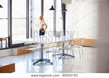 Woman working in empty meeting room