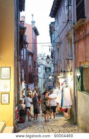 Tourists Walking Next To Souvenir Shops In Rovinj