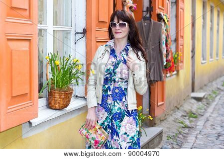 Young Woman In Long Dress Walking In Old Town