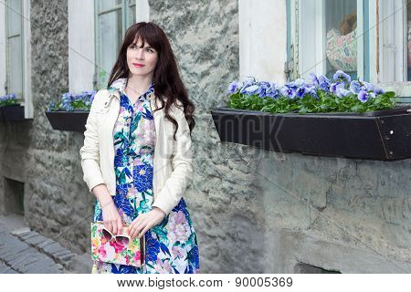 Attractive Woman In Dress With Beautiful Flowers In Old Town