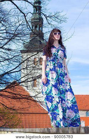 Beautiful Woman Posing Over Old Church In Tallinn