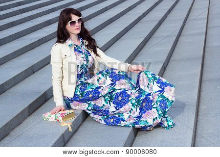 Attractive Woman In Dress Sitting On Stone Stairs