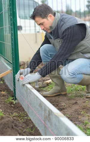 Putting up a fence in the garden