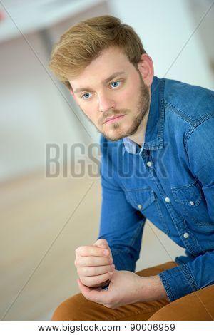 Pensive man on the sofa