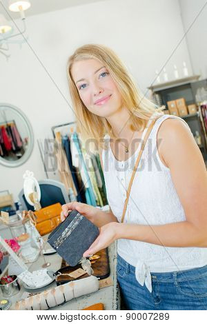 Lady holding purse in a store