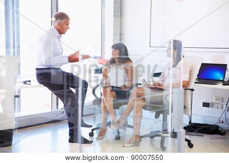 Colleagues talking in a modern office