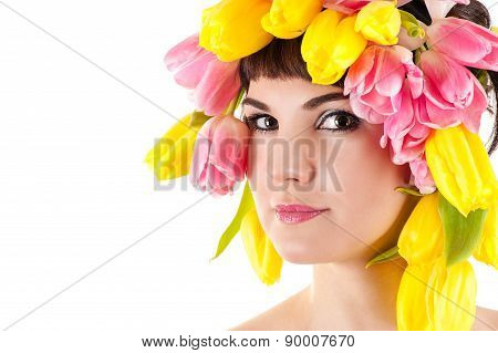 beautiful face of woman with tulips on the head
