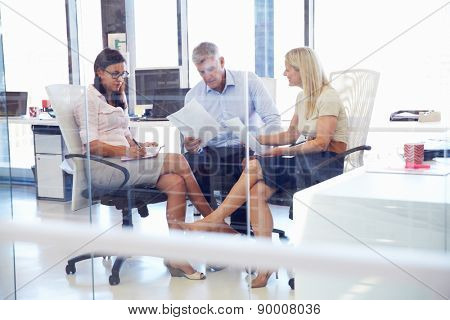 Group of colleagues talking in an office