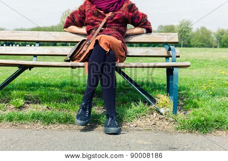 Woman Resting On Bench In Park