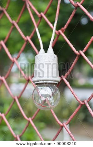 Light Bulb On Fence