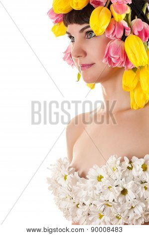 beautiful woman with tulips and chrysanthemums on breasts