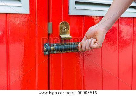 Hand Opening Little Red Door