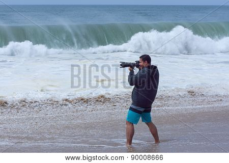 Photographer Shooting Big Surf At California Beach