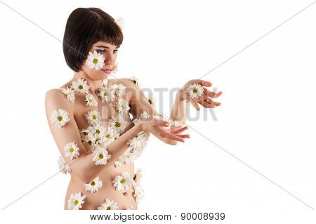 beautiful woman surprised flowering chrysanthemums on the body