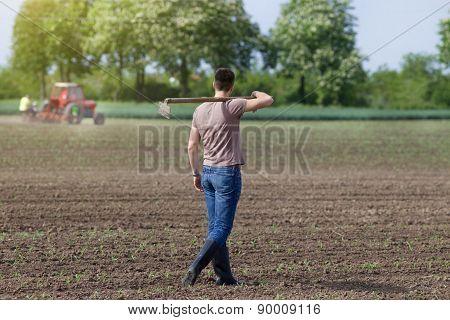 Farmer Walking With Hoe