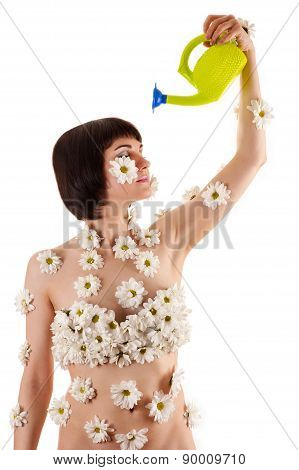woman with chrysanthemums on the body himself watering