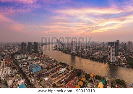 Skyline sunset with riverfront Bangkok Thailand
