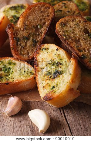 Toasted Bread With Herbs And Garlic Closeup On Paper. Vertical