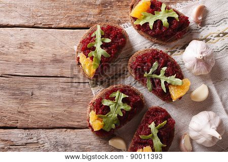 Bread With Beetroot, Oranges And Rucola. Top View Horizontal