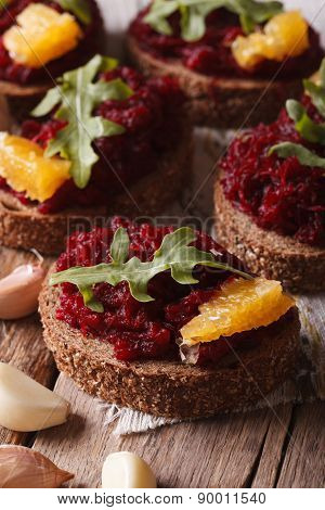 Sandwich With Beets, Oranges And Arugula Close-up. Vertical