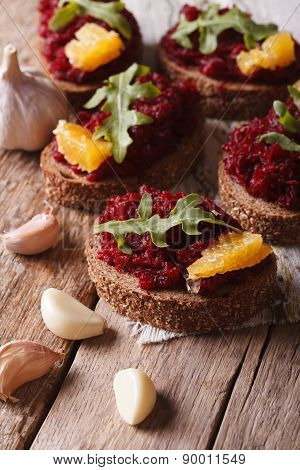 Canape With Beets, Oranges And Arugula Close-up. Vertical