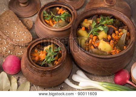 Baked potatoes with mushrooms in pot