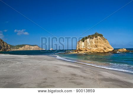 Beautiful paradisiac landscape of islet in front of beach Machalilla National Park, Ecuador