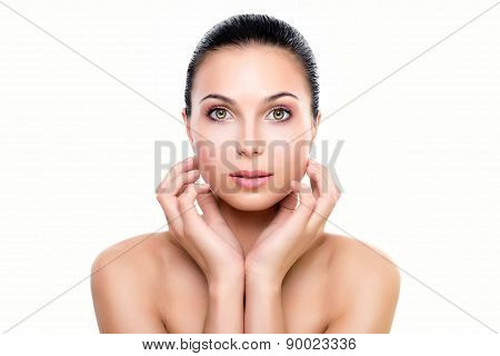 Beautiful Young Woman With Fresh Clean Skin Hands Touching Face. Isolated On White.