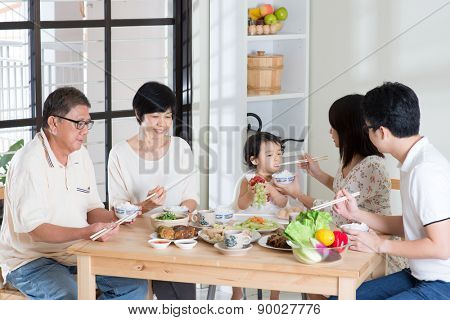 Asian family eating at home. Multi generation having meal, living lifestyle.