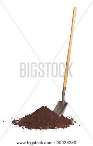 Vertical studio shot of a shovel stuck in a pile of dirt isolated on white background