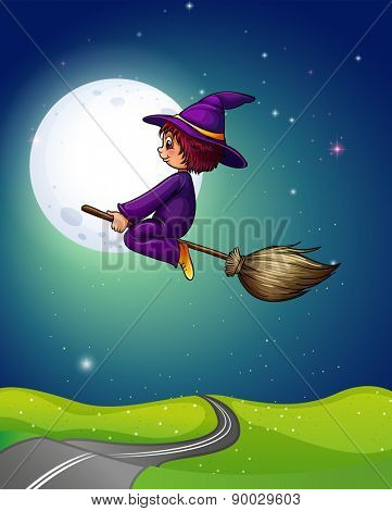 Witch flying a broom in the dark night of fullmoon