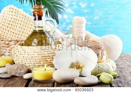 Still life with beautiful blooming orchid flower, spa treatment on bright background