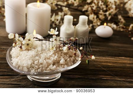 Spa still life with flowering branches on wooden background