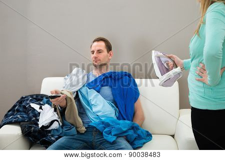 Wife Giving Ironing Work To Husband