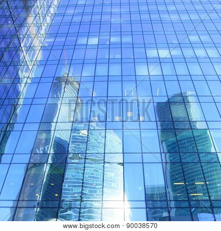Reflections of modern office buildings - architectural and business background