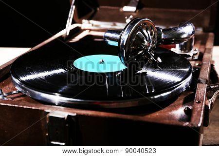 Gramophone with vinyl record, closeup