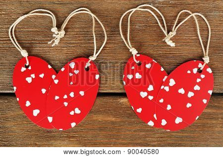 Blank tags on wooden background