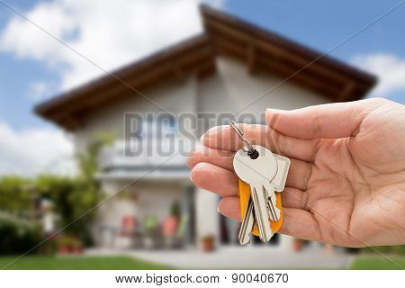 Person Hand Holding House Key