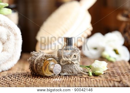 Beautiful spa composition with perfume on table close up