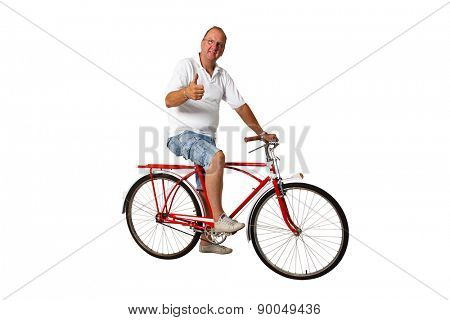 Brazilian man riding an antique bike with thumbs up on an isolated white background