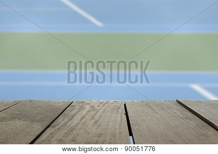 Defocus And Blur Image Of Terrace Wood And Tennis Court For Back