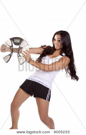 Woman Excited Holding Scales