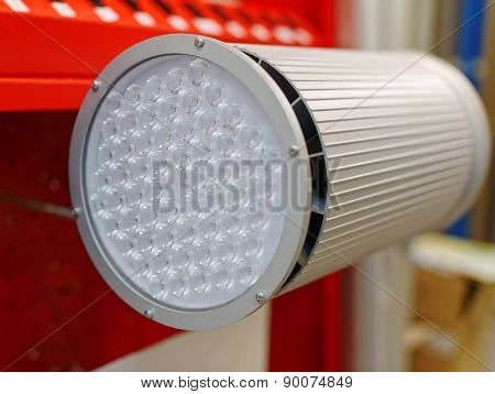 Close-up. Large gray spotlight with round glass. poster